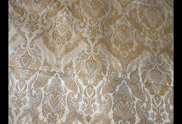 This is a beautiful pure heavy benarse silk brocade floral design fabric in Off white and Gold. The fabric illustrate golden woven floral vines on Navy Blue background. You can use this fabric...