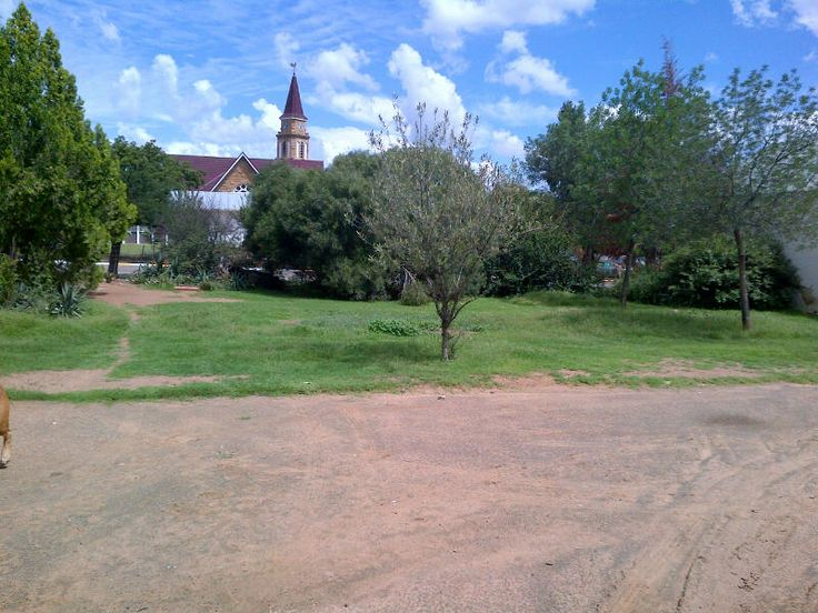View of Reddersburg NG Kerk/Dutch Reformed Church from the yard - barn on right hand side