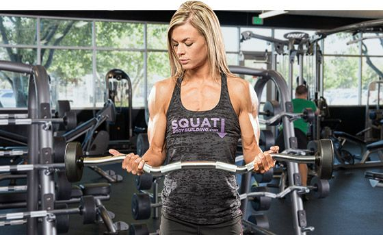 To keep continuous tension in your biceps, stop about six inches from your chest. At the bottom, don't bounce the bar off your thighs.