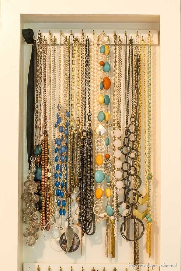 Inset Jewelry Cabinet Part 2 Organizing The Jewelry Infarrantly Creative Necklace Organizer Diy Jewelry Cabinet Necklace Organizer