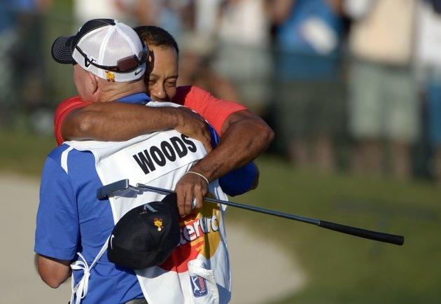 Tiger Woods, rear, embraces his caddie Joe LaCava after winning the Arnold Palmer Invitational golf tournament at Bay Hill in Orlando, Fla., Sunday, March 25, 2012.(AP Photo/Phelan M. Ebenhack)