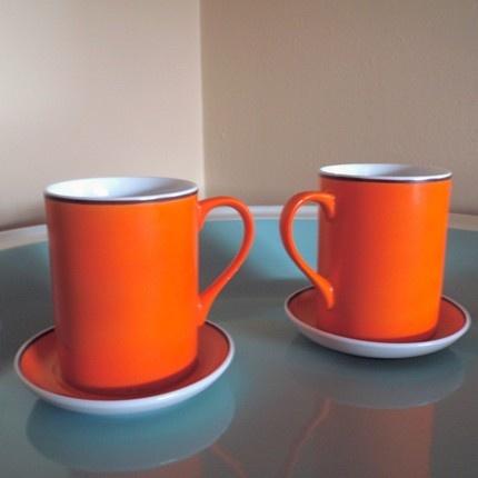 orange cup and saucer set