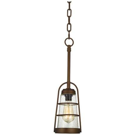 this urbanchic mini pendant light is inspired by rustic and industrial styles an oilrubbed bronze cage surrounds seedy glass where a vintage edison bulb
