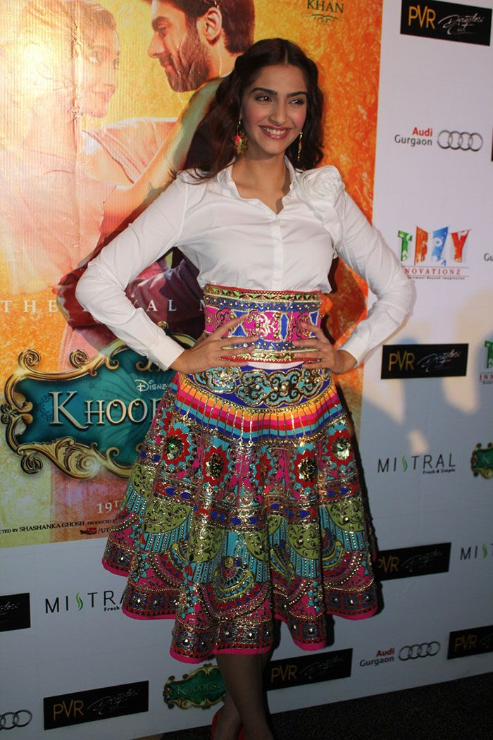 Fashionista Sonam Kapoor looking fabulous in a mutli-coloured high-waist skirt by Manish Arora and a crisp white Valentino shirt. #Bollywood #Fashion #Style #Beauty