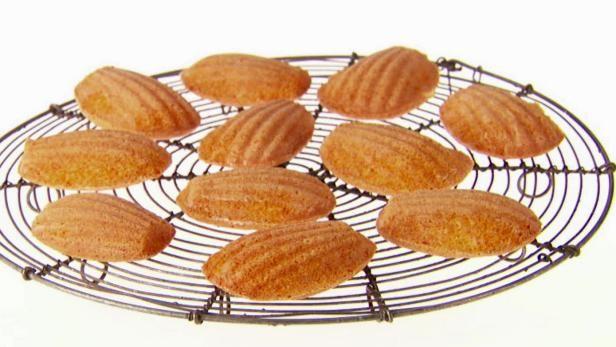 Get Giada De Laurentiis's Honey-Almond Madeleines Recipe from Food Network