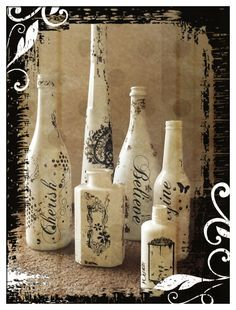 I spray painted bottles white. Added  \'rub on\' words. Makes great table decorations throughout the year. At Christmas time I place holly berries, poinsettia flowers and candles in bottles. During the year I would use seasonal flowers in the bottles
