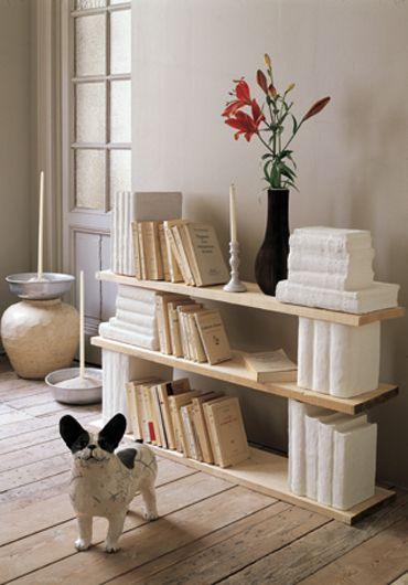 Old books covered with plaster turned into a nice shelf