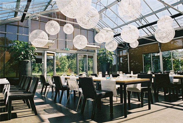 Netherlands This place will bring out your inner hippie. When you dine at De Kas, you are literally dining in a greenhouse. They gro...