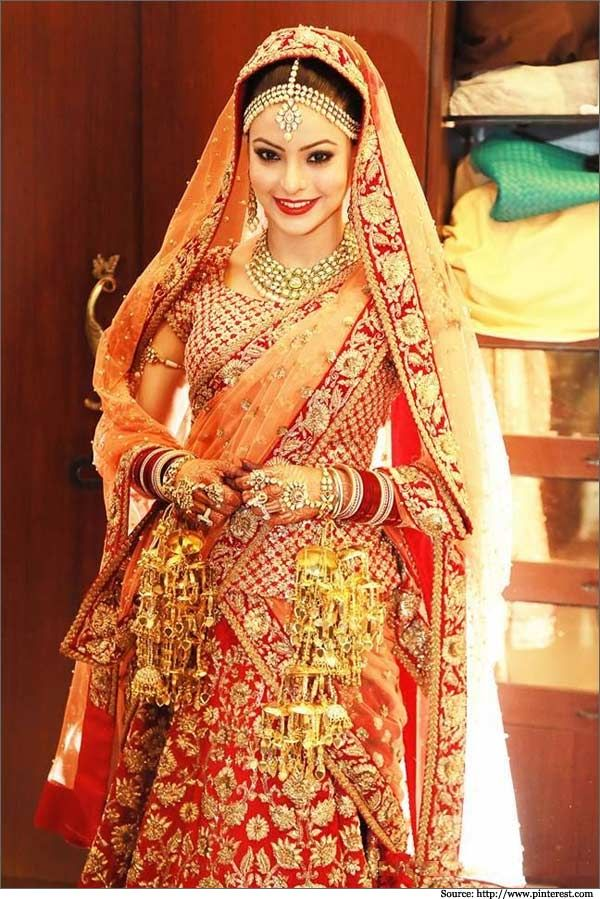 This #Sabyasachi handiwork looks #traditional in the sense of colors and gotawork. #bandbaajabride #bridaloutfits