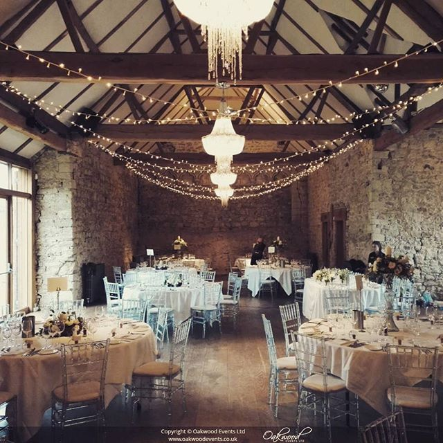P O R T F O L I O // Simple crossed strand canopy for a stylish wedding at Notley Abbey. Flowers by @gingerlilyflowers  #weddingday #receptionstyle #weddingbreakfast #bijou #notleyabbey #fairylights #barnvenue #stylishbride #gingerlily #oakwoodevents