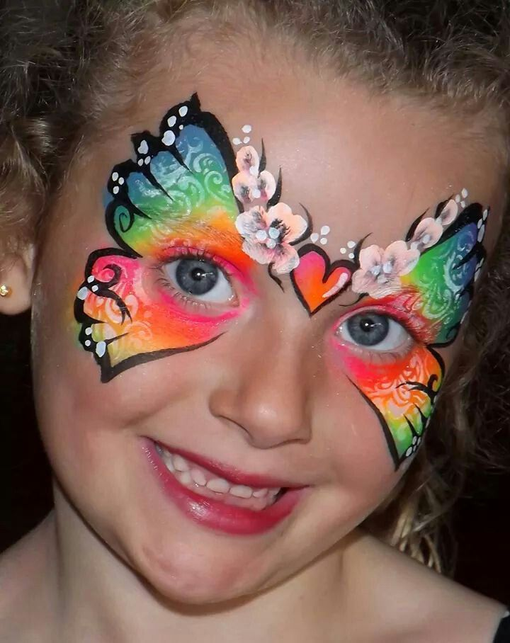 Nicola White Face painter neon butterfly mask face painting design ideas for girls