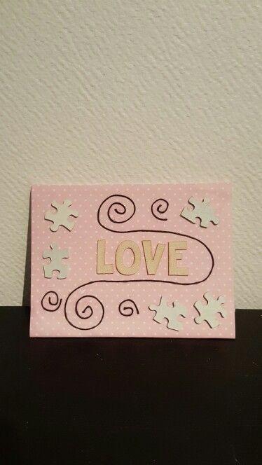 """Tavla med pusselbitar och texten """"Love"""" :)"""