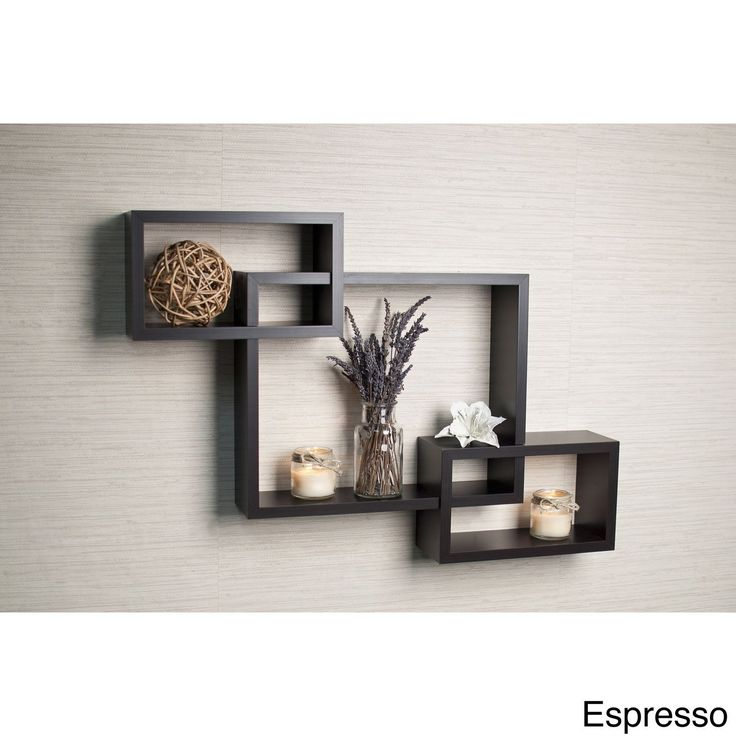 Display your favorite photos or knick-knacks on this laminate decorative wall shelf, which features three intersecting cubbies. The espresso shelf, which is a constructed with no visible connectors, includes all of the hardware necessary for hanging.