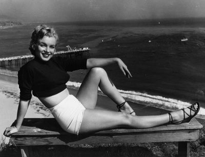 """Marilyn Monroe has held a variety of jobs, from making five cents a week in an Orphan home to a stock contract at a studio. She clicked as the sexy girl in """"Asphalt Jungle"""", and the roles got better. She has been named to Miss Cheesecake of 1951 by stars and stripes, a service paper. (04/17/1951)(AP Photo)"""