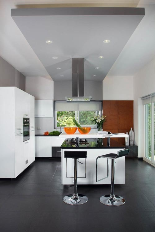 Island kitchen with breakfast counter   - Interior designers bangalore projects | professional interior design company Bangalore | Modern and Retail Interior Designers | Residential Interior Designers | commercial interior designers bangalore