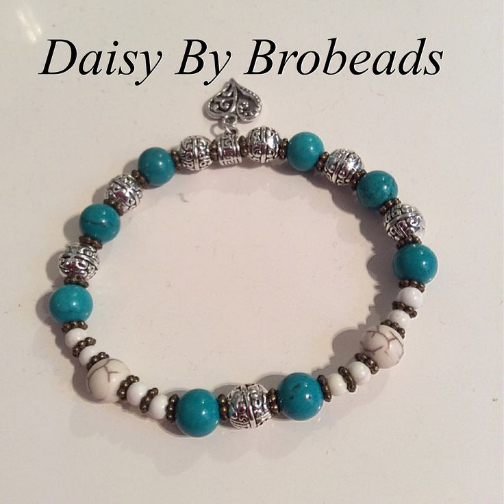 Daisy By Brobeads. Gorgeous ladies bracelet using silver Tibetan spacers white howlite, blue turquoise gemstones, antique bronze daisy spacers, with cute silver heart  charm. OOAK $32.00+p&h  Lindagschaller@ gmail.com