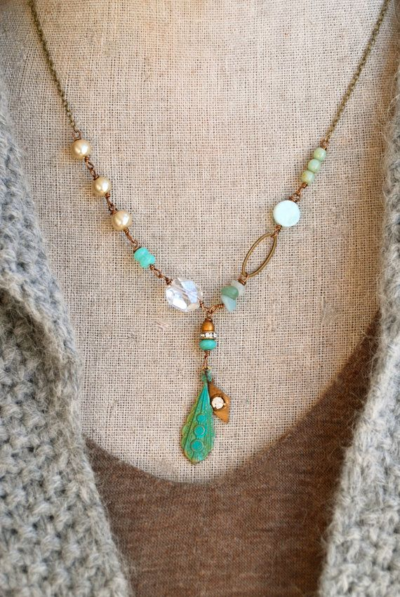 Mia...  was full of creativity   feaures glass beads,cystal ,vintage faux glass pearls,peruvian opal,amazonite gemstones,rhinestone bead,verdigris