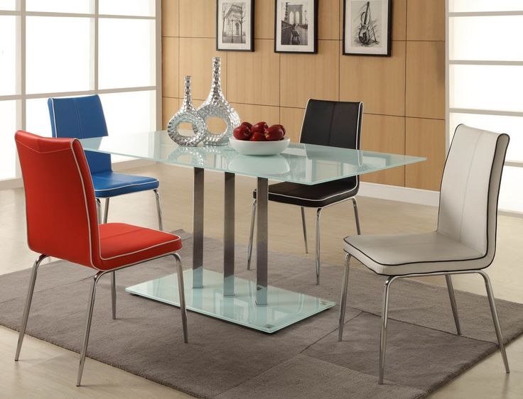 Goran Collection Regular size 5 Pc Dinning Table Set $358 (Table, 4 Chairs)The minimalistic contemporary look of the Goran Collection captures the clean aesthetic that you strive to achieve in your home. The glass tabletop and base are accented by vertical chrome finished supports. Your individual taste comes to the forefront in the chairs that you choose to accompany your tableFinish:WHITE GLASS finishDimensions:Table:36 x 63 x 29HChair:17 x 22 x 37.5H (Black, Blue, Red, White)