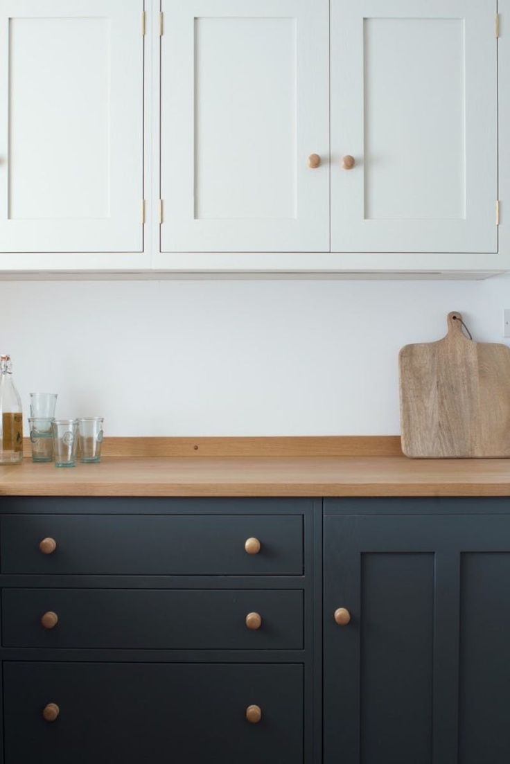 Two toned shaker cabinets in the kitchen with simple knobs and counter