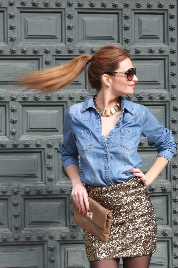 A baby blue denim shirt and a gold sequin mini skirt will give off this very sexy and chic vibe.  Shop this look for $90:  http://lookastic.com/women/looks/sunglasses-necklace-denim-shirt-mini-skirt-clutch/6103  — Brown Sunglasses  — Gold Necklace  — Light Blue Denim Shirt  — Gold Sequin Mini Skirt  — Brown Leather Clutch