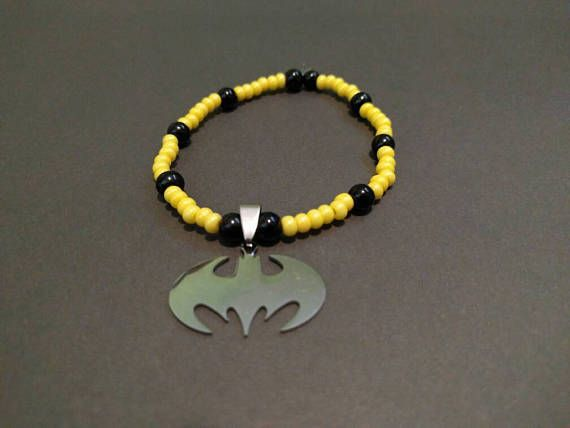 Check out this item in my Etsy shop https://www.etsy.com/listing/537337343/batman-charm-bracelet-yellow-and-black