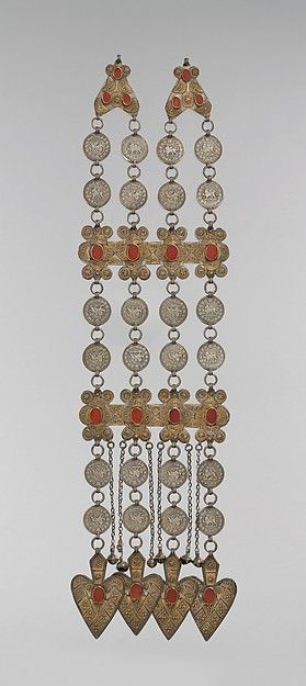 Dorsal Plait Ornament. Date: late 19th–early 20th century. Geography: Central Asia or Iran. Culture: Islamic. Medium: Silver; fire-gilded with stamped and applied decoration, with Persian silver coins, table-cut carnelians, loop-in-loop chains, bells, and cordiform pendants.