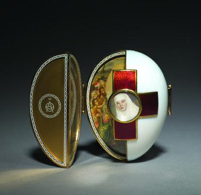 Red Cross egg with Triptych - 1915. Nicholas II presented it to his wife Empress Alexandra Fyodorovna. The center of each cross is set with a painted miniature of respectively the Grand Duchess Olga and the Grand Duchess Tatiana in their Red Cross uniforms. The central scene is the Harrowing of Hell, the Orthodox representation of the Resurrection. Saint Olga, the founder of Christianity in Russia is represented on the left wing of the triptych. The martyr Saint Tatiana on the right.