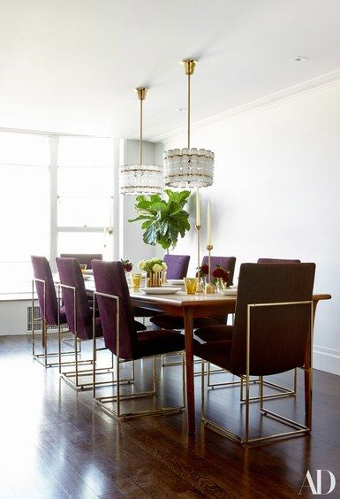 A custom dining table by Jonah Zuckerman of City Joinery sits under a pair of 1960s Danish chandeliers purchased on 1stdibs | archdigest.com