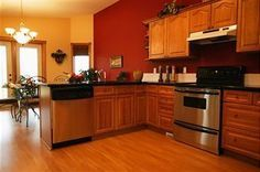 red kitchen walls with medium brown cabinets | ... kitchens with oak cabinets…