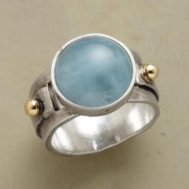 Sea blue aquamarine cabochon is set on a sterling silver bezel and band, accented with 14kt gold beads. Exclusive. Whole sizes 5 to 9.