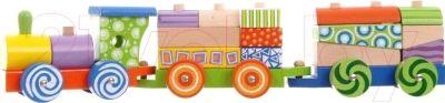 Игра с развивающей игрушкой Eco Toys Поезд с кубиками 2009 положительно влияет на развитие мелкой моторики, координации движений, логического мышления.Ваш ребёнок почувствует себя машинистом поезда, направляющегося в дальнее путешествие.