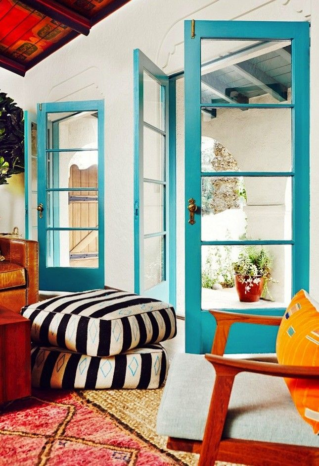Let in those tropical vibes no matter where you live by painting doors a bright turquoise.