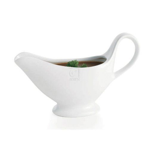 This beautiful Home Essential gravy boat is the perfect way to serve your guests your delicious sauce or gravy. This beautiful piece will blend well with any dinnerware. The porcelain boat is 10 OZ. Made in China. Made of White porcelain Practical and contemporary Dishwasher safe