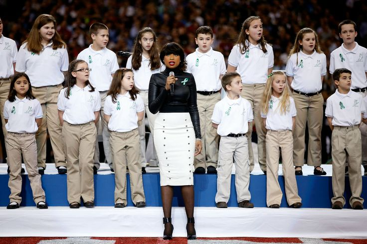 Singer Jennifer Hudson performs 'America The Beautiful' with the Sandy Hook Elementary School Chorus prior to the start of Super Bowl XLVII