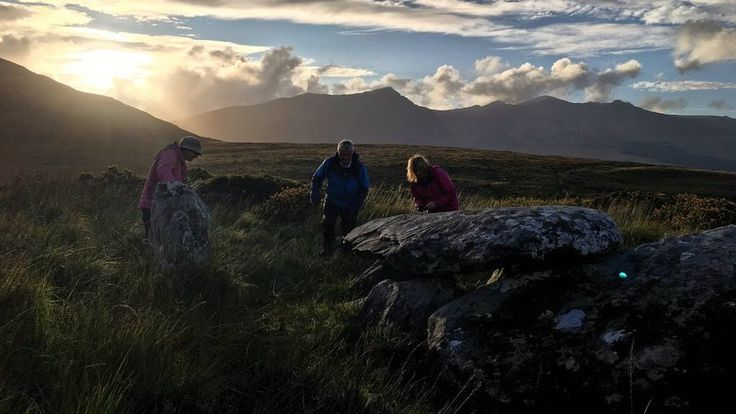 The tomb on the Conor Pass on Kerry's Dingle Peninsula: As the sun sets directly into a 'V' shaped valley in the distant Brandon mountain range, a shaft of light enters the wedge tomb, illuminating the chamber and the rock art at the head of the tomb. The event can be witnessed at sunset for a number of days either side of the equinox.