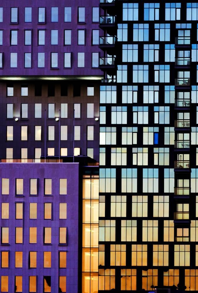 Colorful neighborhood  Buildings of The Barcode Project reflect a sunset in Oslo on Nov. 18. The row of new high-rise buildings are part of a redevelopment on former dock and industrial land in central Oslo, due to be completed in 2014.