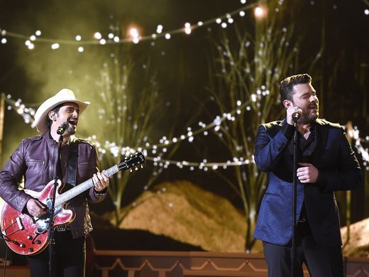 Brad Paisley performs with Chris Young at the CMA Country