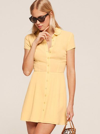 Like your dream vintage dress except better because it actually fits you. This is a mini length, fit and flare dress with a collar and center front buttons.