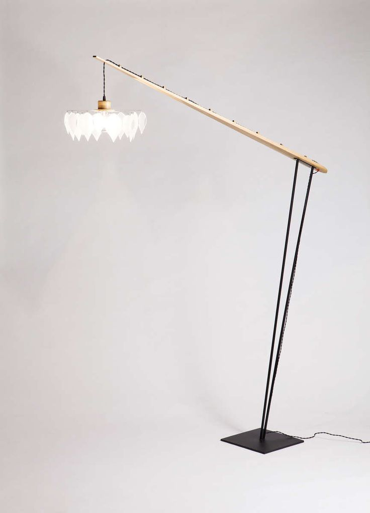 Li.Mod.Pad.F Floor lamp with steel base and arm from solid wood. The lamp has dimmable light and braided fabric cable.