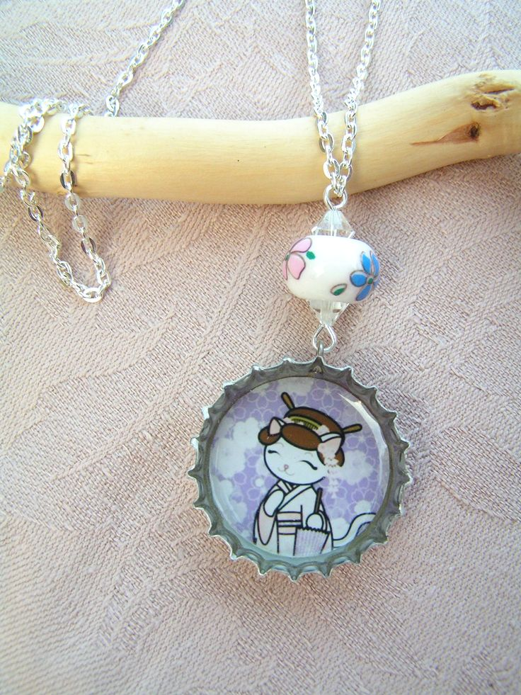 Geisha Cat    necklace in silver coloured bottle cap, completed with a hand painted porcelain bead and swarovski crystals. Charming and elegant accessary in a same time