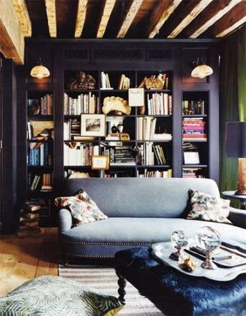 Modern home library with a blue sofa, via @sarahsarna:
