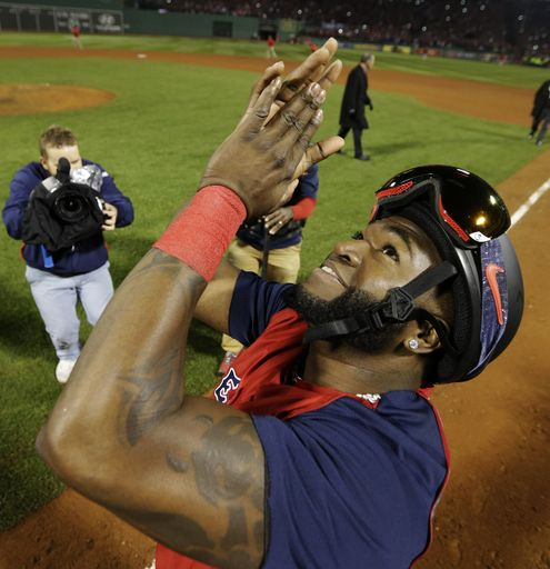 Boston Red Sox designated hitter David Ortiz applauds after defeating the St. Louis Cardinals in Game 6 of baseball's World Series Wednesday...