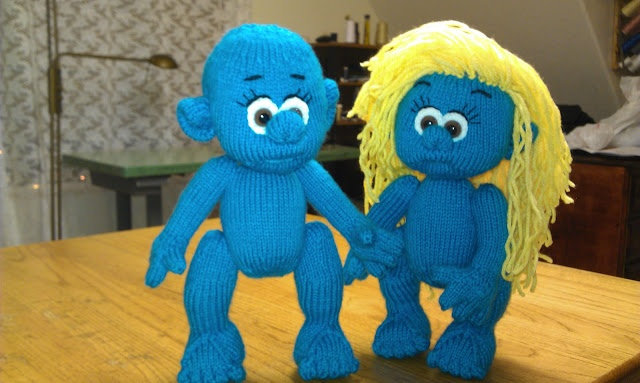 Knitted Smurf and Smurfette dolls