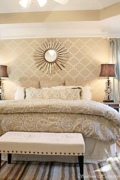 love the stenciling over the bed
