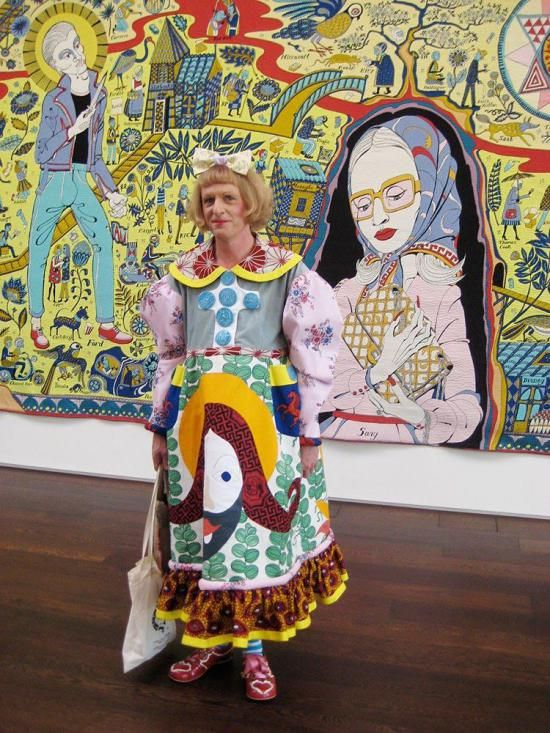 Grayson Perry with one of his tapestries