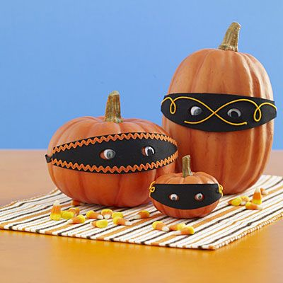 Go incognito    Mask your pumpkins' true identity with a cute homemade disguise. No carving is needed to create this festive pumpkin face, making it a great kid-friendly craft.