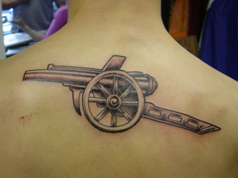 I love this detailed Cannon tattoo... not mine but considering similar!