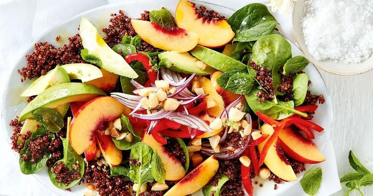 Make your table pop with Curtis Stone's vibrant summer salad tossed with quinoa, fresh fruit and toasted macadamias.