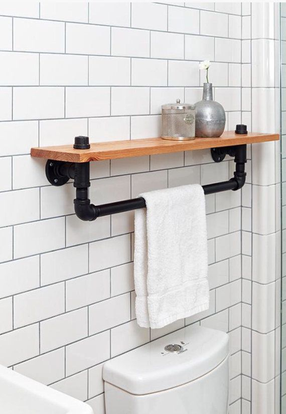 This stunning handcrafted wall mounted industrial iron pipe shelf with towel bar is assembled out of black steel pipe and wood. It will make
