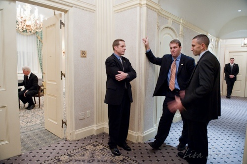 Clinton with his secret service always nearby...